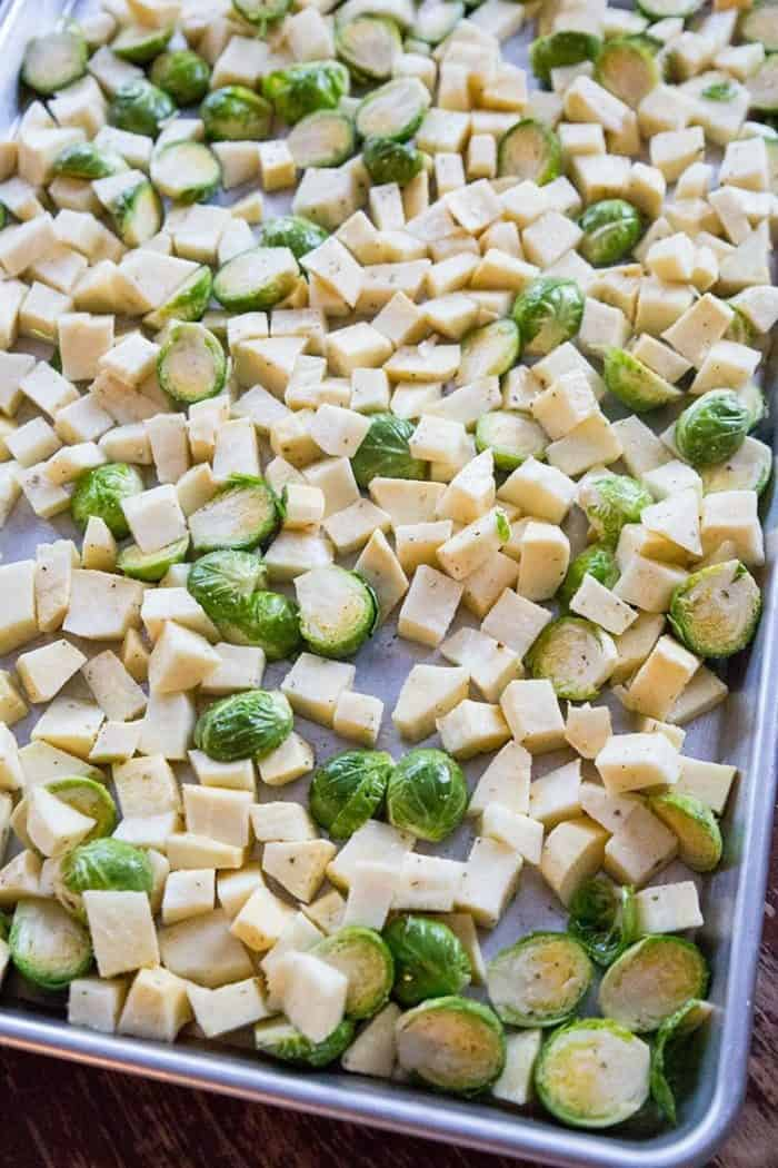 Cubed White Sweet Potato and Sliced Brussels Sprouts in a Large Baking Sheet
