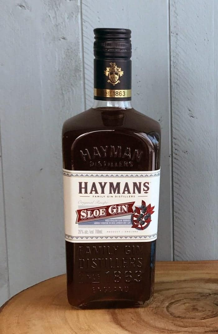 a bottle of Hayman's Sloe Gin on wood