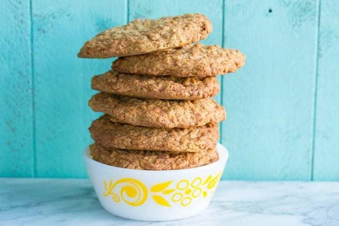 Butterscotch Oaties, AKA Oatmeal Scotchies Cookies in a white bowl on jade blue wood background