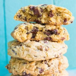 Close up Stack of Walnut Loaded Chunky Chocolate Chip Cookies in Ruffle Plate on Blue Background