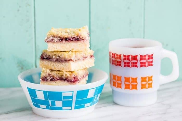 Coconut Grape Jam Bars - The most delicious squares that you will try this year! From @kitchenmagpie