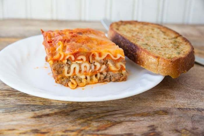 Easy Cottage Cheese Lasagna in white plate with a slice of bread toast