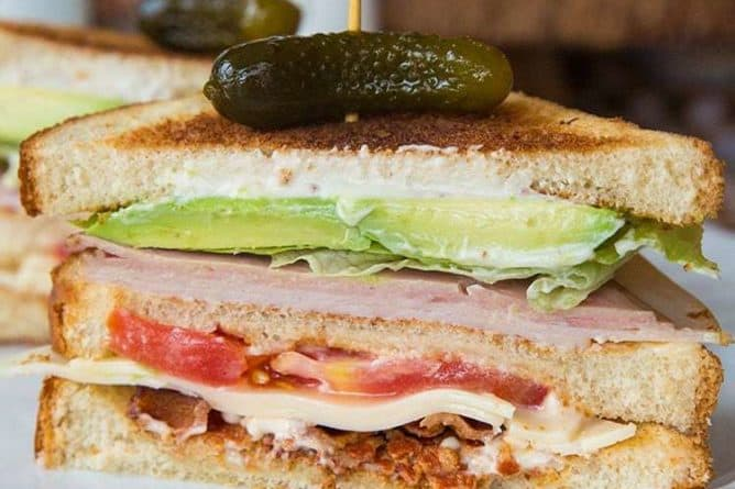 Clubhouse Sandwich topped with Gherkins pickles