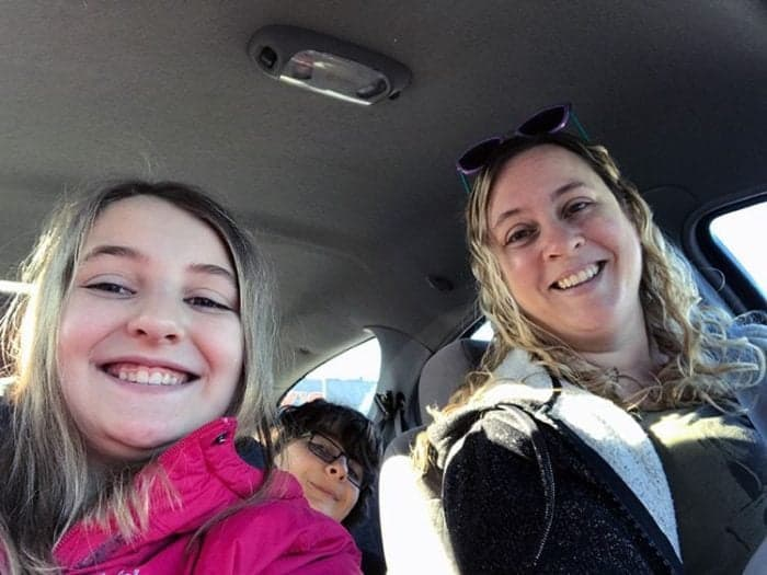 kids with their mom having fun inside the car