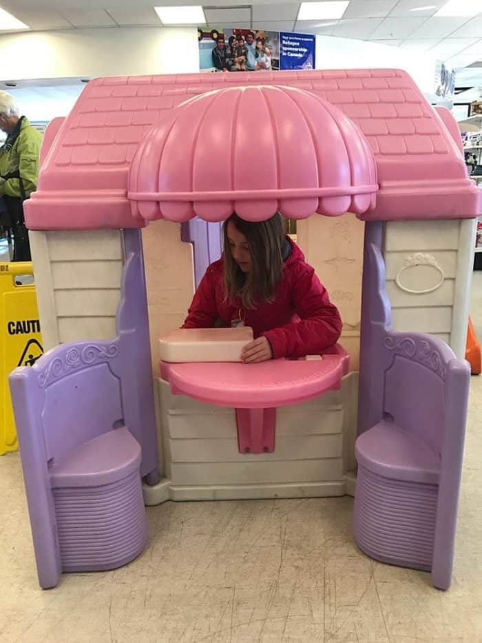 pink, cream and violet colored playhouse