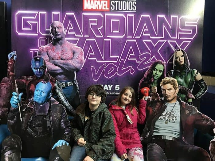 kids' photo at the theater with the guardians of galaxy characters background