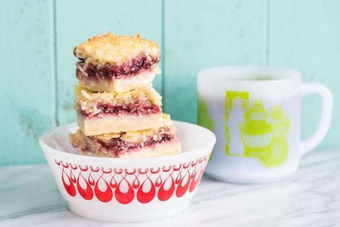 Raspberry Coconut Bars, the perfect bar recipe! It freezes well and tastes amazing!