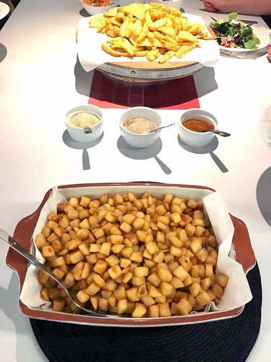 Homefries, Savoury Potato Wedges and Dips on table