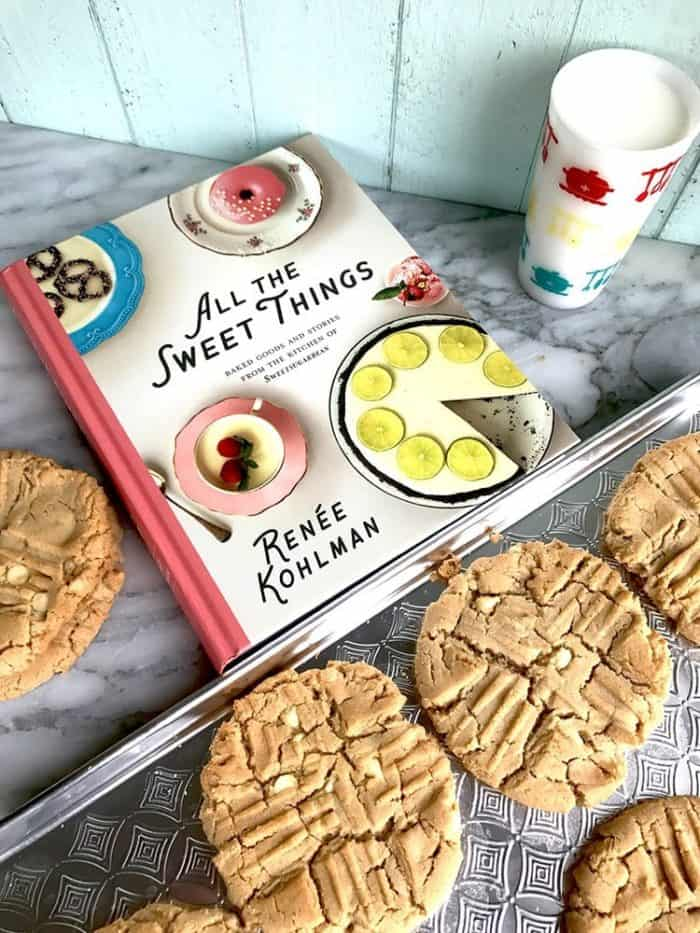 Renée Kolhman cookbook with giant white chocolate peanut butter cookies around it