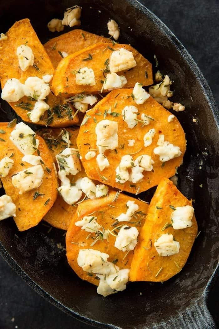 Sweet Potatoes with Herbed Feta cheese, thyme and rosemary in a Large Bowl