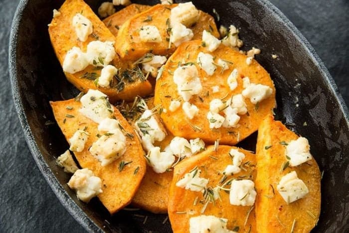 Top down shot of Baked Herbed Sweet Potatoes & Feta in Large Bowl