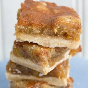 close up stack of Butter Tart Bars in a dessert plate on white background