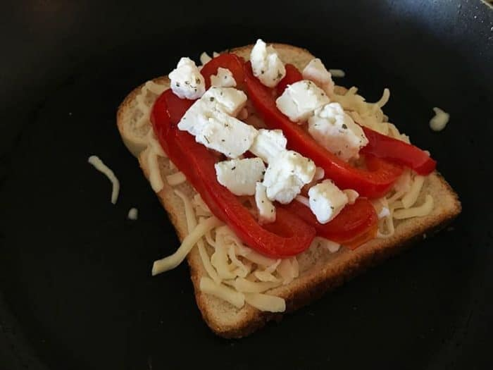 bread with sliced red pepper and cheese on top