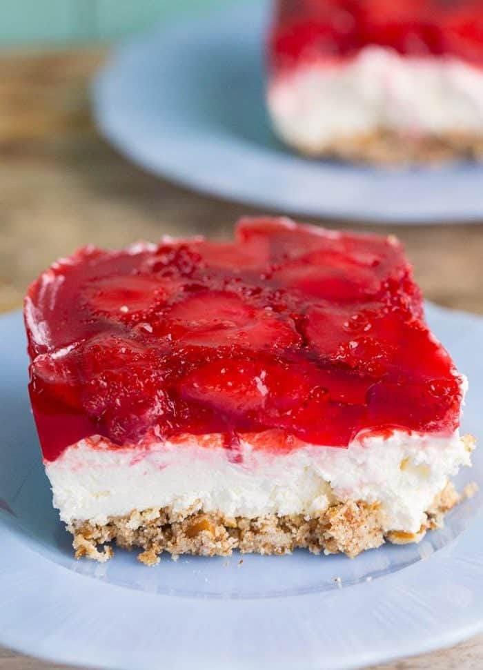 Slice of Strawberry Pretzel Salad in a Pyrex plate