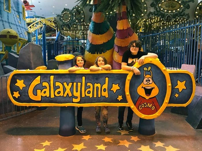big Galaxyland signage in front of three kids