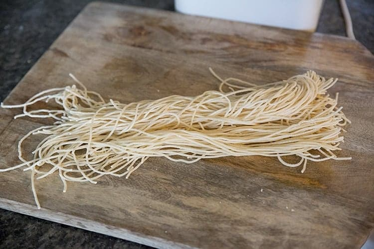 fresh raw pasta on top of wooden table