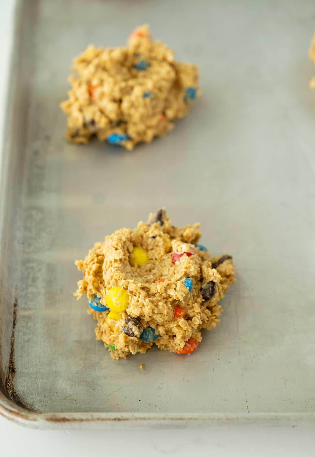 large scoop of monster cookie batter in baking sheet