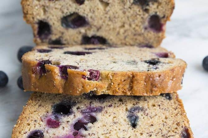a loaf of Blueberry Banana Bread with 2 slices
