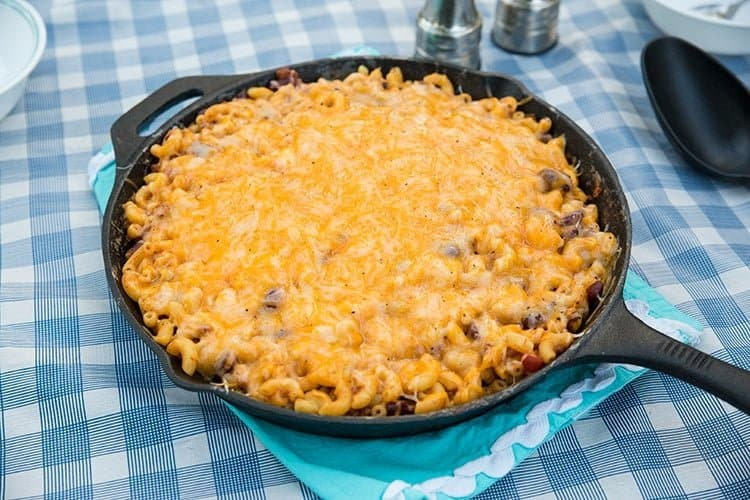 Campfire Cheater Chili Mac Skillet with a blue tablecloth underneath