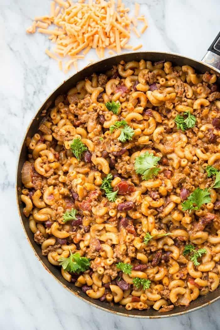 This Homemade Cheesy Chili Mac Skillet has two secret ingredients that make this the BEST cheesy chili mac skillet you are ever going to eat! I promise!