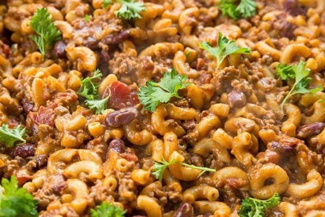 Close up Cheesy Chili Mac Skillet topped with parsley