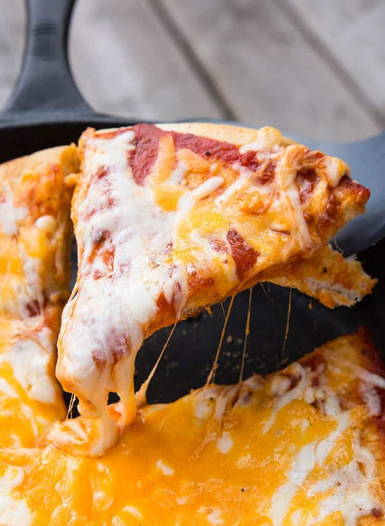 a slice of cheesy campfire pizza
