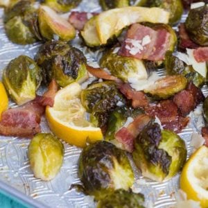 Close up of Crispy Lemon Bacon Roasted Brussels Sprouts in a baking sheet