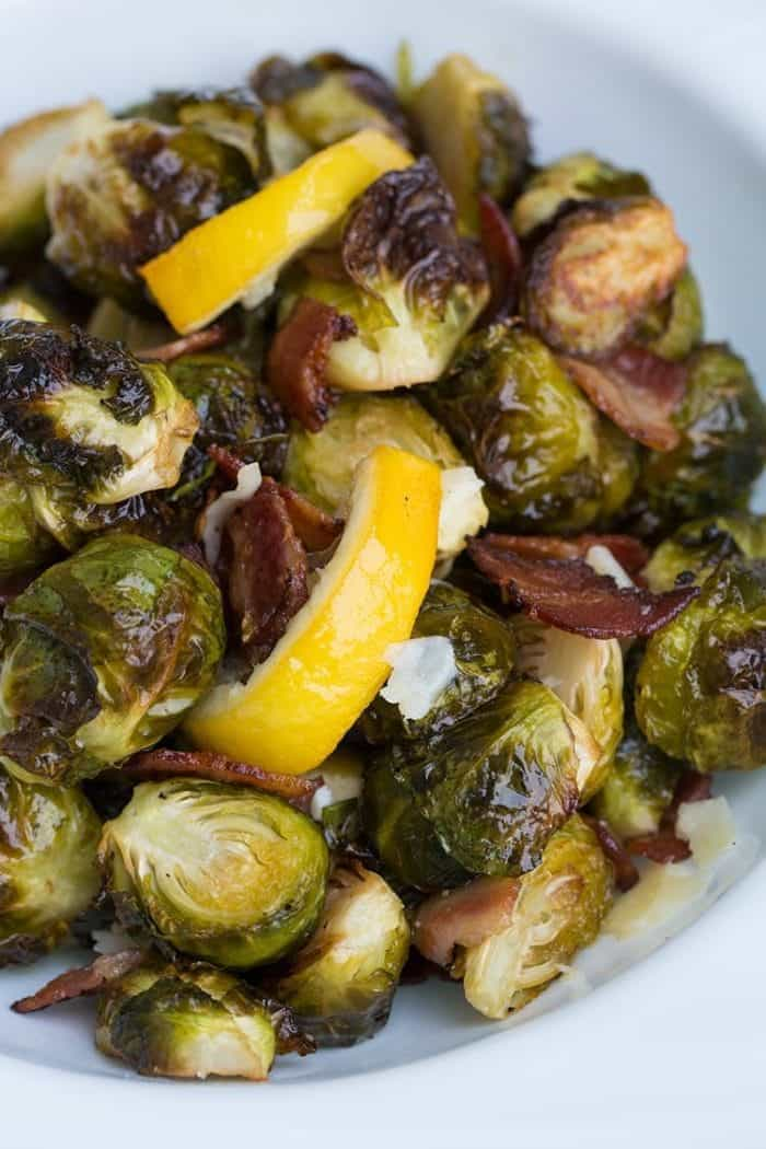 Close up of Crispy Lemon Bacon Roasted Brussels Sprouts in white bowl