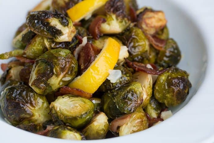 Crispy Lemon Bacon Roasted Brussels Sprouts in white bowl