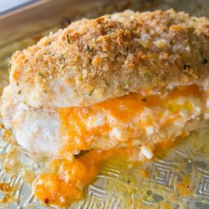 close up of Lemon Garlic Double Cheese Stuffed Chicken in baking sheet