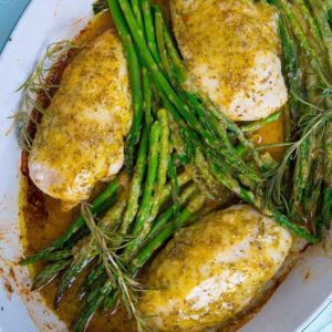 Top down shot of Lemon Chicken with Rosemary & Asparagus in white pan