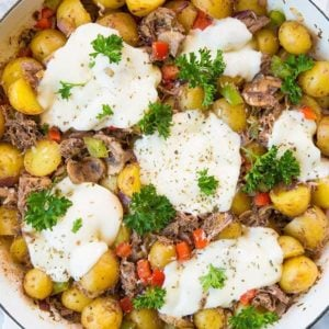 top down shot of Cheesy Italian Beef Breakfast Skillet in a marble background