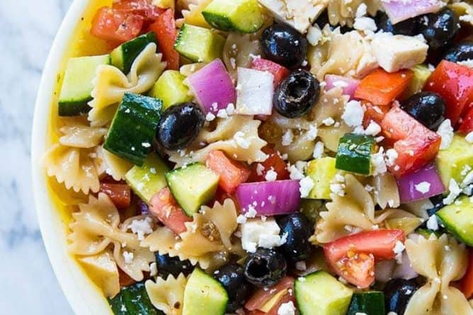 close up Greek Pasta Salad, loaded with mixed olives, cucumber and artichoke