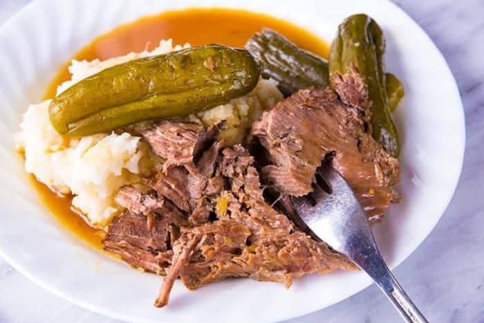 DILL PICKLE POT ROAST & PICKLE GRAVY! If you love pickles you are going to flip for this pot roast! Similar to the Mississippi Pot Roast but NOT spicy and infused with a fabulous pickle taste! Even the gravy is spectacular! Recipe from @kitchenmagpie #slowcooker #roastbeef #potroast #recipes