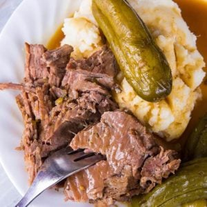 Dill Pickle Pot Roast & Pickle Gravy in white plate