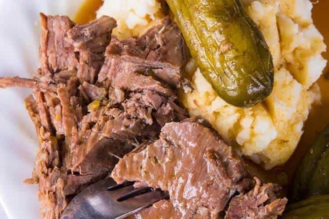 Dill Pickle Pot Roast & Pickle Gravy in white plate