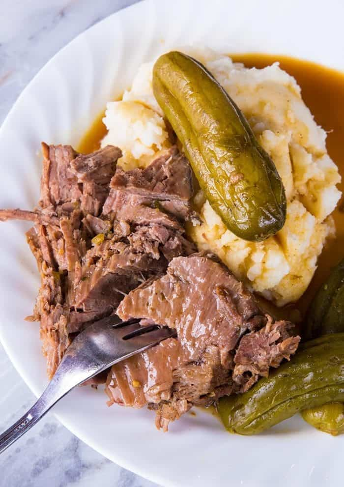 Dill pickle Beef instant pot dinner served with mashed potatoes on a white plate