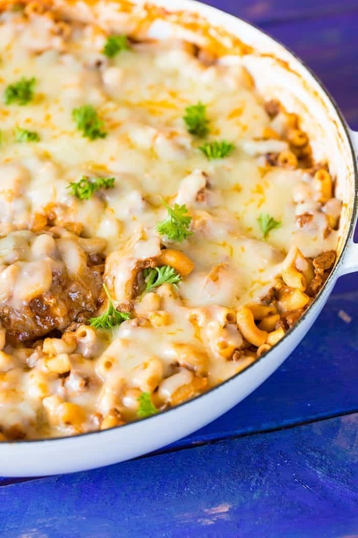 sloppy joe mac and cheese in a large white enamel skillet