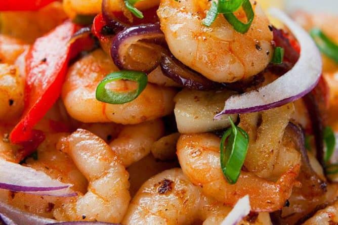 close up of Garlic Shrimp Stir-Fry with Peppers & Onions in a white bowl