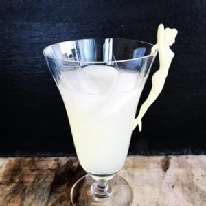 a glass of Honeysuckle Cocktail with a white vintage party girl fork on side
