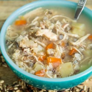 no dairy Chicken & Wild Rice Soup in a jade blue soup bowl