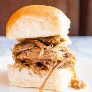 close up Slow Cooker Pulled Pork on toasted buns