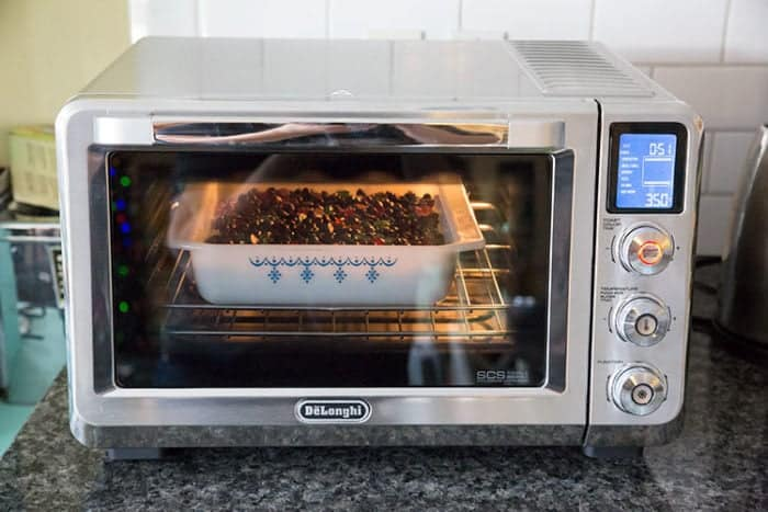Christmas Magic Bars in a baking dish inside the De'Longhi Livenza Convection Oven