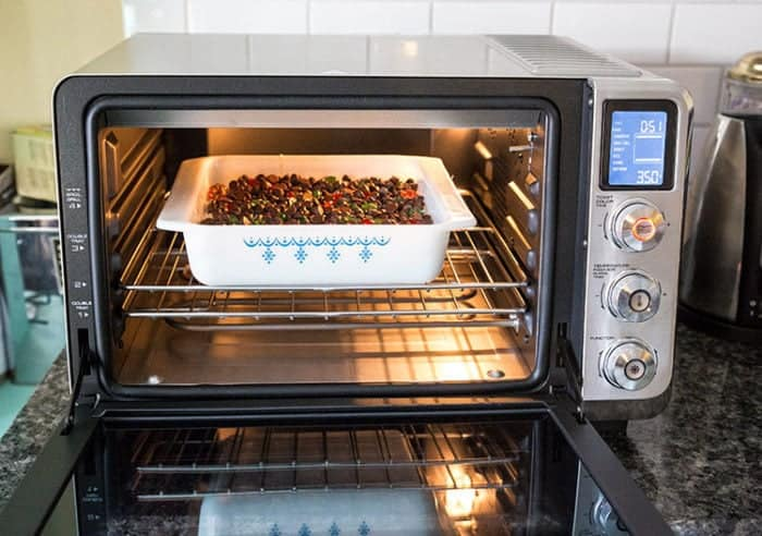 the De'Longhi Livenza Convection Oven with baking dish inside