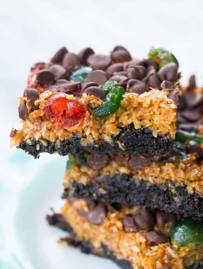 close up stack of Christmas Magic Cookie Bars slices