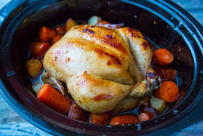Crockpot Honey Garlic Whole Chicken & Vegetables! Roast a whole chicken in your crockpot with a delicious honey garlic sauce & vegetables for the perfect easy dinner!! Recipe from @kitchenmagpie #dinner #chicken #crockpot #slowcooker #recipe #recipes #honeygarlic
