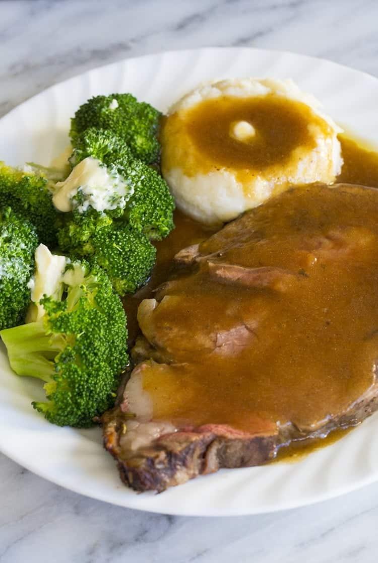 Herb & Garlic Stuffed Prime Rib Roast Recipe in a white plate