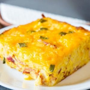 Double Cheese Overnight Breakfast Hashbrown Casserole in a white plate