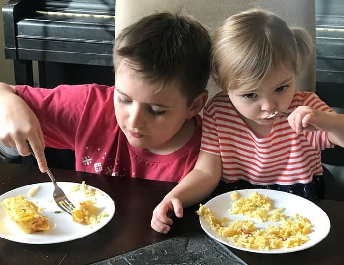 kids enjoying the Hash Brown Casseroles in their plates