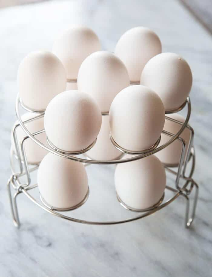 2 stack of egg racks with eggs